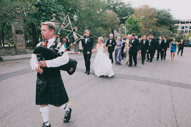 Bagpiper leading bride and groom