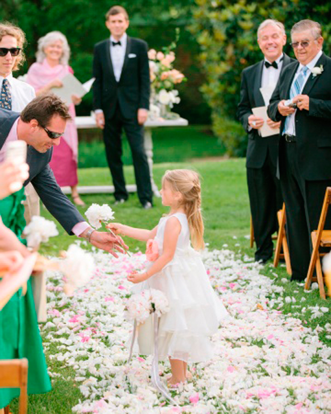 Flower girls hand out flowers